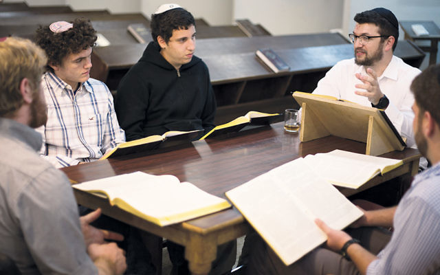 Rabbi Ari Yablok leads a study session. (Photos by Sam Lutfi)