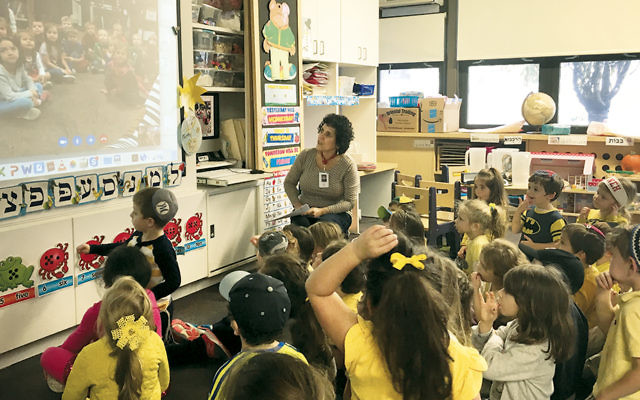Students at Yavneh Academy in Paramus enjoy making contact with other pupils through the Global Read Aloud Program via Skype.