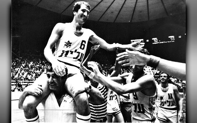 Jubilant Israeli basketball players celebrate after their stunning 1977 upset of the Soviet Union team.