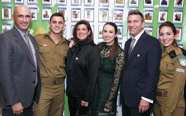 FIDF NJ Planning Committee member Adam Schlesinger of West Orange, left, with his son, IDF Lone Soldier Sgt. Ari, his wife, Judy, also an FIDF NJ Planning Committee member, and their daughter, Rachel; FIDF supporter Joseph Isaacs of Teaneck, and his daughter, IDF Lone Soldier Cpl. Eliana. Photos by Aron Michael