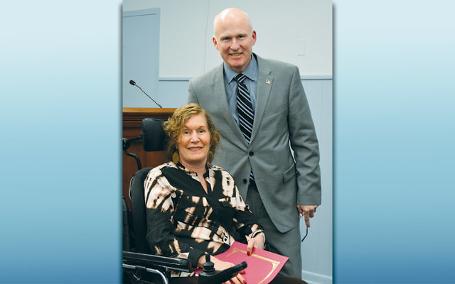 Park Ridge Mayor Terry Maguire presents a community service award to Jacqueline Bollens. (Photo provided)