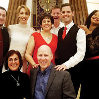"""The Fair Lawn Jewish Center/CBI held """"From Stage to Screen,"""" an evening of Broadway and movie music. Event organizers Andrea and Scott Pass, sitting, joined the performers and instrumentalists. (Courtesy FLJC/CBI)"""