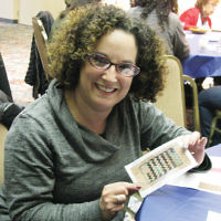 Temple Beth Tikvah of Wayne's Women of Chai group, including Suzanne Goldensohn, pictured, created needlepoint mezuzahs, donated food to the WIN-Wayne Interfaith Network, and enjoyed a homemade dessert buffet. (Courtesy TBT)