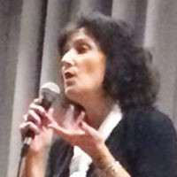 """The JCC of Paramus/Congregation Beth Tikvah held its """"Evening of Fun and Laughter"""" with comedy headliner Robin Fox at mic. Comedian Doug Adler also performed. Refreshments included liquors and a pudding bar. (Courtesy JCCP/CBT)"""