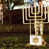 On December 9, Rabbi Noah Fabricant of Temple Beth Or in Washington Township lit the Chanukah menorah at the township's annual holiday celebration at Veterans Square Park. (Courtesy TBO)