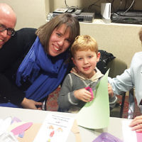 Miriam Goldfarb, right, a Jewish Home Assisted Living resident, is pictured with Avi Kawalsky and Suzanne Anziska (Ms. Goldfarb's granddaughter), and their son, (Ms. Goldfarb's great-grandson), Natie Kawalsky. JHAL residents, families, and children enjoyed a day of crafts, and intergenerational activities last month at a Sunday Funday program. (Courtesy Jewish Home Family)