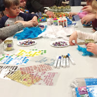 As part of Temple Beth Or in Washington Township's pre-Chanukah celebration, teens held a Mitzvah Market to raise funds for organizations including Billy's BASEballs, First Book, Keshet, Midnight Run, New Eyes For The Needy, Ramapo-Bergen Animal Refuge, and Table to Table. Toddlers made crafts, pictured, in a Holiday Happenings program, and the sisterhood held a lobby holiday sale to raise funds. (Courtesy TBO)