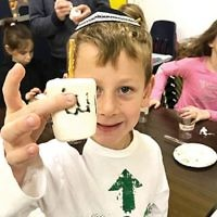 Students in the Glen Rock Jewish Center's Hebrew school made edible Chanukah dreidels. (Courtesy GRJC)