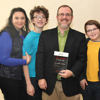 """Rabbi David Fine of Temple Israel & JCC in Ridgewood, center, is shown with his family; from left, his father, Rabbi Robert, his wife, Alla, their sons, Laurence and Ariel, and his mother, Helene. They were at a celebration to mark the publication of Rabbi Fine's latest book, """"Passionate Centrism: One Rabbi's Judaism"""" with a launch party at the synagogue last month. He will lead a series of free lectures on the book starting January 22. (Courtesy TIJCC)"""
