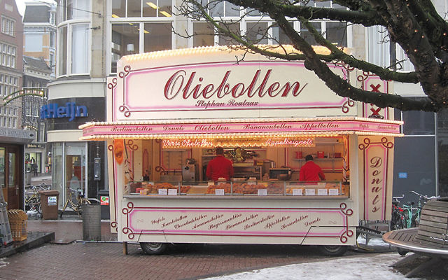 Oliebollen are sold in stalls like this throughout Amsterdam this time of year. (Kate Hopkins/Flickr)