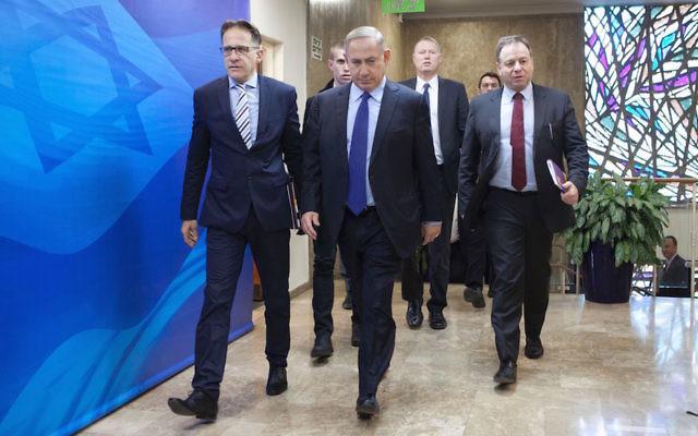 Israeli Prime Minister Benjamin Netanyahu, center, arriving at his weekly Cabinet meeting in Jerusalem, Dec. 25, 2016. (Dan Balilty/AFP/Getty Images)