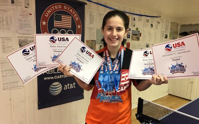 Estee Ackerman holding certificates representing the five medals she won in this month's U.S. Open in table tennis. (Courtesy of Estee Ackerman)