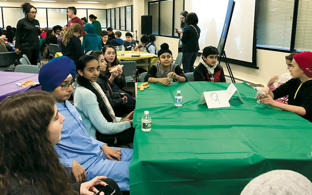 Middle schoolers from different religious communities gathered at the Jewish Federation of Northern New Jersey on Martin Luther King Day.