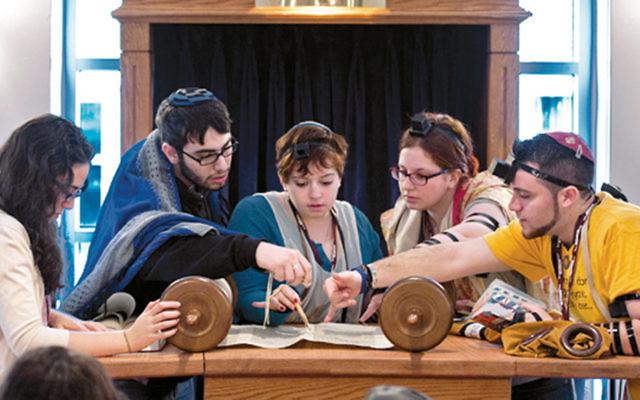 Masorti on Campus participants read Torah in a weekday service.