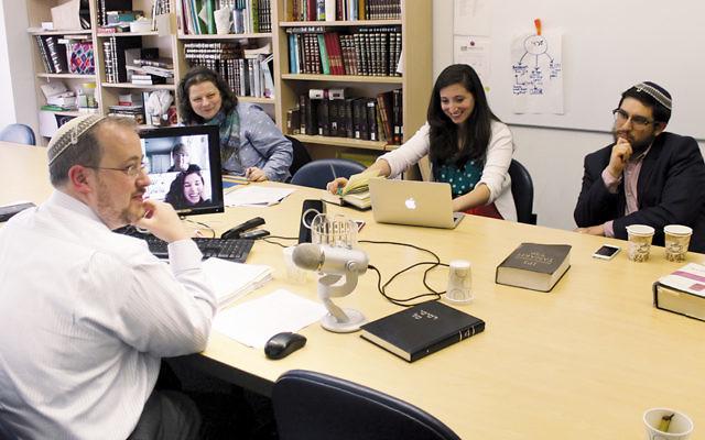 Rabbi Jeffrey Fox, rosh yeshiva of Yeshivat Maharat, teaches a class in Jewish law. (JTA/Uriel Hellman)
