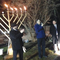 From left, Rabbi Dov Drizen of Valley Chabad  and Cantor Alan Sokoloff of Temple Emanuel of the  Pascack Valley join Woodcliff Lake's Mayor Carlos A.  Rendo at the Borough of Woodcliff Lake's menorah lighting.