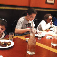 From left, Jacob Herman, 8, Penina Kirscher, 15, Liam Leibowitz, 10, and Yehoshua Danzger, 7, competed in the kids' division in the annual Teaneck latke-eating contest at Noah's Ark.
