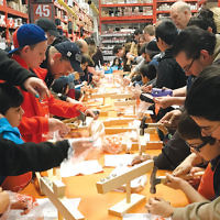 The Chabad Jewish Center of Upper Passaic County partnered with the local Home Depot and hosted a menorah-building workshop at the store. More than 50 children participated.  (Photo courtesy Chabad)