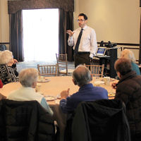 """Participants of Temple Emanu-El of Closter's Hazak, a program for seniors, enjoyed a morning of """"Jewish Jeopardy"""" and lunch with Rabbi Alex Freedman. (Courtesy Emanu-El)"""