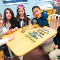 Young students at Shomrei Torah in Wayne learned to set a Shabbat table and braid challah using Play Doh. (Courtesy Shomrei Torah)