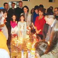 """Temple Beth El of Northern Valley held its 20th annual """"101 Menorahs"""" Shabbat on December 30. A festive oneg with sufganiyot followed. (Courtesy TBENV)"""