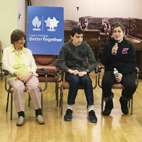 Students from the Bergen County High School of Jewish Studies who participate in the Jewish Volunteer Corps' yearlong class visited with residents of the Daughters of Miriam Center in Clifton, sharing stories about bar and bat mitzvahs, weddings, and visits to Israel. The students will continue to visit residents throughout the year to build relationships, learn their Jewish histories, and document them in photos and videos. (Courtesy BCHSJS)
