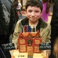 Ilan Mendelson of Teaneck with the 770-One Mission-One Nation menorah he entered in Tenafly's Lubavitch on the Palisades community menorah contest. (Courtesy LOTP)