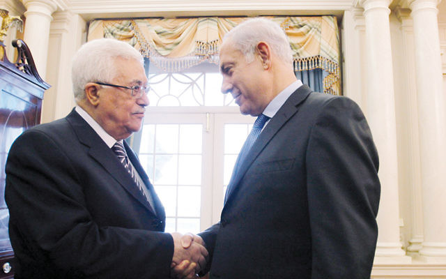 Palestinian Authority President Mahmoud President Abbas, left, shakes hands with Israeli Prime Minister Benjamin Netanyahu before peace talks at the State Department in Washington, D.C., on September 2, 2010. (Jason Reed-Pool/Getty Images)
