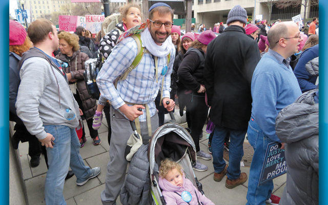 Josh Weinberg, the president of ARZA, the Association of Reform Zionists of America, and his daughters at the Women's March. (Ron Kampeas)
