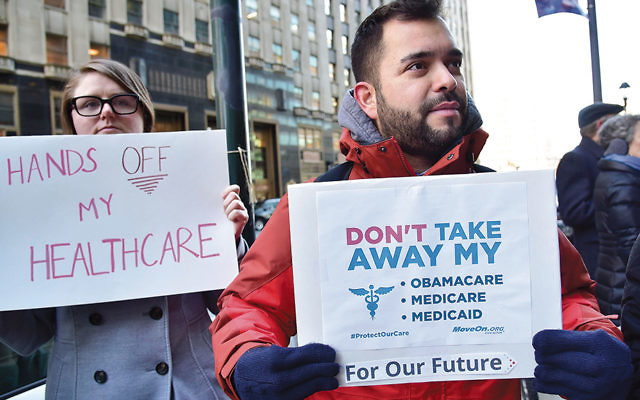 Protestors in Philadelphia rally in support of the Affordable Care Act on December 20, 2016. (Lisa Lake/Getty Images for Moveon.org)