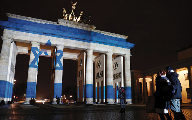 An image of an Israeli flag was projected onto the Brandenburg Gate in Berlin earlier this month.  (Odd Anderson/AFP/Getty Images)