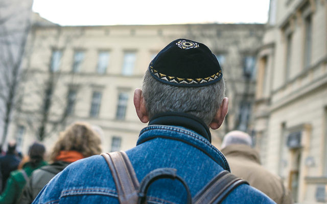 A man wearing a kippah takes part in a silent march last November in Berlin to commemorate the 75th anniversary of the 1938 Kristallnacht pogroms. (Carsten Koall/Getty Images)