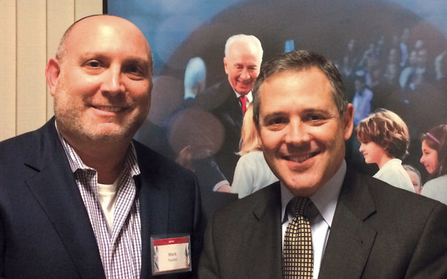 Mark Tanchel, left, AIPAC chair for Temple Emanuel of the Pascack Valley in Woodcliff Lake, with featured speaker David Gillette.