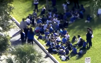 The scene outside a JCC in Miami Beach, Fla., after a bomb threat was received on Monday. (JNS.ORG/YouTube)