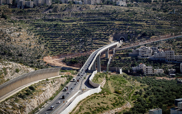 The West Bank security fence that runs near Jerusalem as it looked in April 2016. (Wisam Hashlamoun/Flash90)