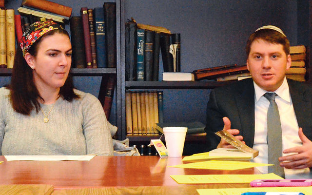 """Sarah Rindner and Rabbi Daniel Fridman lead a discussion of """"Lila"""" at the Jewish Center of Teaneck. (Michael Laves Photographer)"""