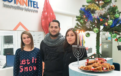 Innitel employs Jews, Muslims, and Christians; here, Arab staff members are at the joint Chanukah-Christmas party. (Innitel)