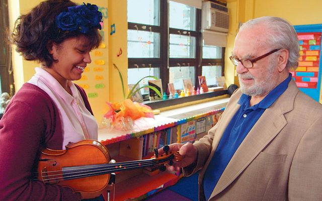 """Joe Feingold and Brianna Perez in the Oscar-nominated short documentary """"Joe's Violin."""" (""""Joe's Violin"""")"""