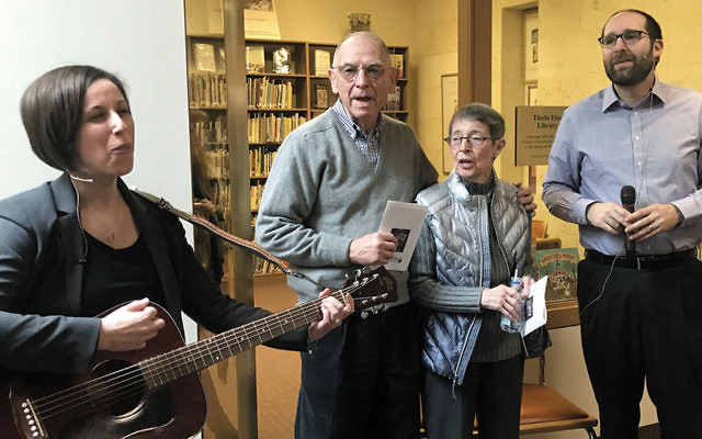 """Cantor Sarah Silverberg, left, with Herb and Theda """"Teddy"""" Fine and Rabbi Noah Fabricant, sing the Shehecheyanu prayer together. (Courtesy TBO)"""