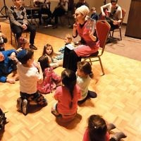 Children from Congregation Shomrei Torah's Parent-Child Learning program and the Leah Sokoloff Nursery School in Fair Lawn joined for a musical Havdalah pajama party. The program included dinner making havdalah candles and silly besamim (spice) holders, dancing, story time, and the bedtime Shema. The Cowbells, pictured, Shomrei Torah members, entertained. (Courtesy LSNS)