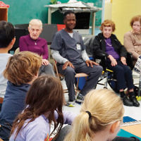 """Several staff members and residents from the Jewish Home at Rockleigh visited the Luther Lee Emerson School in Demarest last week. It was part of a Kids4Caring program during a school """"Career Day"""" event. The children will attend the residents' upcoming production of the """"Sound of Music"""" at the Jewish Home. (Courtesy Jewish Home Family)"""