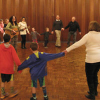 On February 5, Temple Beth Tikvah in Wayne celebrated Tu b'Shvat with a seder led by Rabbi Meeka Simerly and Cantor Charles Romalis. It included the four questions, song, dance, fruits, a bagel brunch, and children's craft session. (Courtesy TBT)