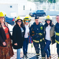 A delegation of Jewish Federation of Northern New Jersey women recently visited Nahariya, JFNNJ's sister city in Israel. They met with relatives of Adar Barsano, an IDF soldier who died during Operation Protective Edge. Federation has named its executive conference room after Barsano. Adar's father, Gil, left, is a firefighter in the Nahariya Fire Department. With him are Gale S. Bindelglass, Franci Steinberg, Dana Post Adler, and Suzette Diamond. Two Nahariya firefighters stand between them. (Courtesy Federation)