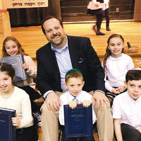 Rabbi David-Seth Kirshner joins Solomon Schechter Day School second graders from Temple Emanu-El of Closter and friends at their Chumash ceremony. (Courtesy Emanu-El)