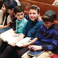 Third and fourth graders from the religious school at Temple Beth Tikvah in Wayne recently led kabbalat Shabbat services. They sang with Rabbi Meeka Simerly and participated in a question and answer session about Israel. (Courtesy TBT)