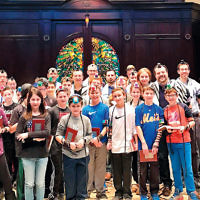 Temple Emanu-El of Closter's sixth and seventh graders and families joined Rabbis David-Seth Kirshner and Alex Friedman and Cantor Israel Singer to participate in the World Wide Wrap. (Courtesy Emanu-El)