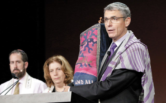 Rabbi Rick Jacobs, president of the Union for Reform Judaism, leads services at the movement's biennial conference in Orlando in 2015. (URJ)