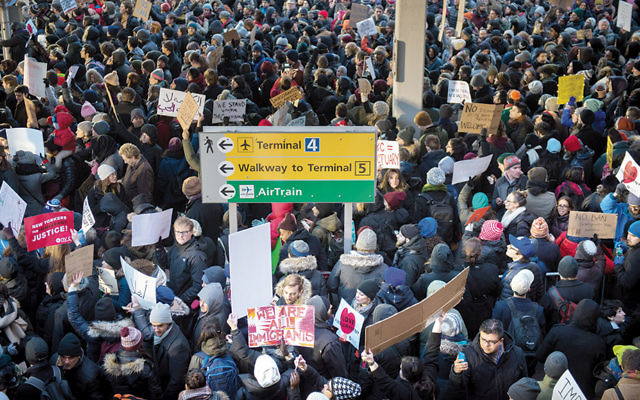 Demonstrators at John F. Kennedy Airport in New York protest President Donald Trump's executive order on immigration on January 28. (Bryan R. Smith/AFP/Getty Images)