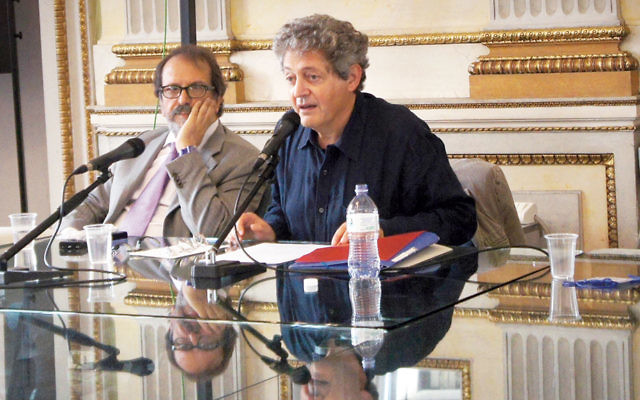 Georges Bensoussan, right, at a talk with Mino Chamla in Milan, Italy, on September 16, 2014. (Moked/Federico Valente)
