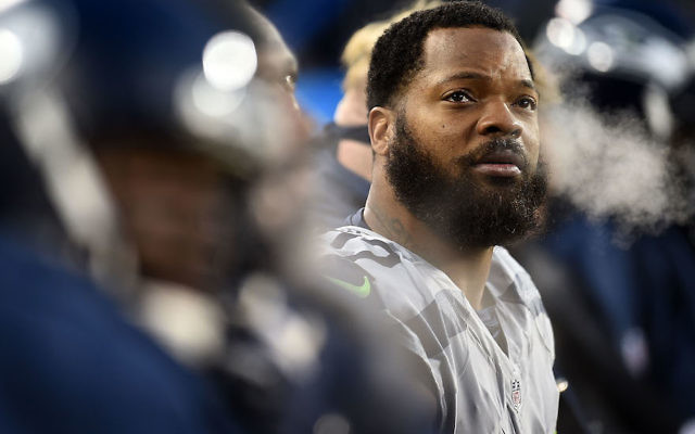 GREEN BAY, WI - DECEMBER 11:  Michael Bennett #72 of the Seattle Seahawks watches action during the 1st half of a game against the Green Bay Packers at Lambeau Field on December 11, 2016 in Green Bay, Wisconsin.  (Photo by Stacy Revere/Getty Images)